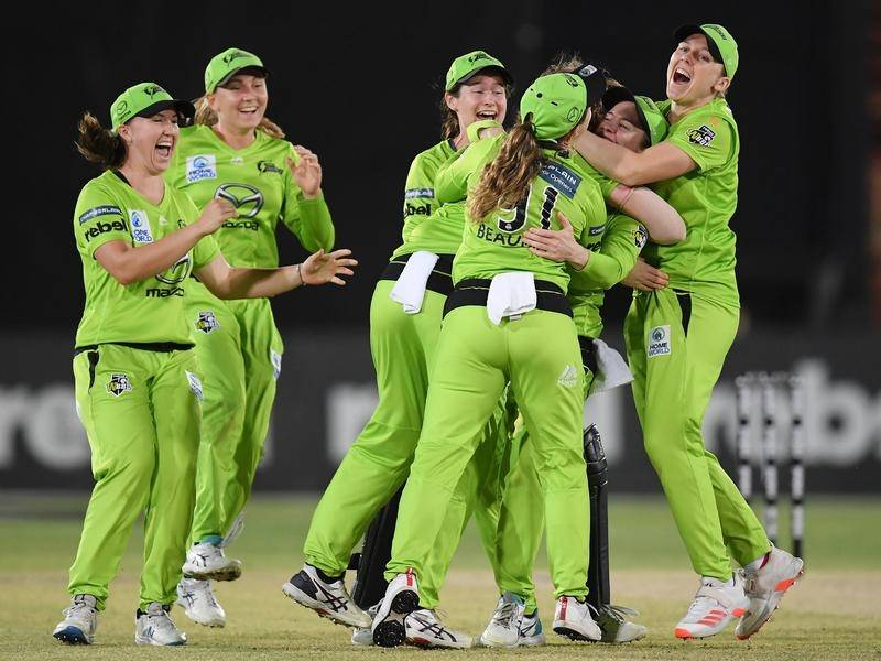 Sydney Thunder players celebrate the final wicket of their WBBL semi-final win over Brisbane Heat.